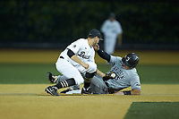 Wake Forest Demon Deacons second baseman Michael Turconi (6) fields a throw as Brett Centracchio (5) of the Davidson Wildcats slides into second base during the game against the Davidson Wildcats at David F. Couch Ballpark on May 7, 2019 in  Winston-Salem, North Carolina. The Demon Deacons defeated the Wildcats 11-8. (Brian Westerholt/Four Seam Images)