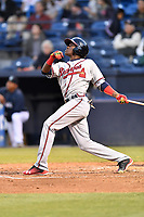 Rome Braves third baseman Jean Carlos Encarnacion (18) swings at a pitch during a game against the Asheville Tourists at McCormick Field on April 17, 2018 in Asheville, North Carolina. The Tourists defeated the Braves 1-0. (Tony Farlow/Four Seam Images)