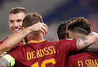 Calcio, Serie A: Roma vs Palermo. Roma, stadio Olimpico, 23 ottobre 2016.<br /> Roma's Leandro Paredes, second from right, partially seen, celebrates with teammates, from left, Edin Dzeko, Daniele De Rossi and Stephan El Shaarawy, right, after scoring during the Italian Serie A football match between Roma and Palermo at Rome's Olympic stadium, 23 October 2016. Roma won 4-1.<br /> UPDATE IMAGES PRESS/Riccardo De Luca