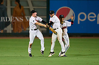 Jupiter Hammerheads outfielders Troy Johnston (6), J.D. Orr (12), and Victor Mesa Jr. (10) celebrate closing out a game against the Palm Beach Cardinals on May 11, 2021 at Roger Dean Stadium in Jupiter, Florida.  (Mike Janes/Four Seam Images)