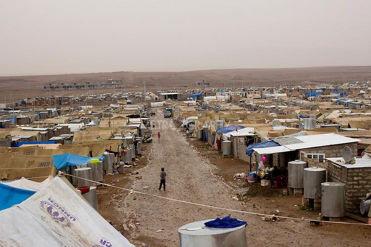 DOMIZ, IRAQ: The Domiz refugee camp in the Kurdish region of northern Iraq...The semi-autonomous region of Iraqi Kurdistan has accepted around 60,000 refugees from war-torn Syria. Around 20,000 refugees live in the Domiz camp which sits 60 km from the Iraq-Syria border...Photo by Younes Mohammad/Metrography