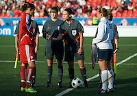 Christine Sinclair, referee Darci Kruse, Christie Rampone during the coin toss. The US Women's National Team defeated the Canadian Women's National Team, 4-0, at BMO Field in Toronto during an international friendly soccer match on May 25, 2009.