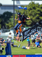 A skydiver delivers the match ball during day one of the international cricket 1st test match between NZ Black Caps and England at Bay Oval in Mount Maunganui, New Zealand on Thursday, 21 November 2019. Photo: Dave Lintott / lintottphoto.co.nz