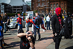 © Joel Goodman - 07973 332324. 30/07/2017 . Manchester , UK . A man carries another dressed as Spiderman in the crowds outside the venue . Cosplayers, families and guests at Comic Con at the Manchester Central Convention Centre . Photo credit : Joel Goodman