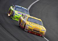 Feb 22, 2009; Fontana, CA, USA; NASCAR Sprint Cup Series driver Clint Bowyer leads Mark Martin during the Auto Club 500 at Auto Club Speedway. Mandatory Credit: Mark J. Rebilas-