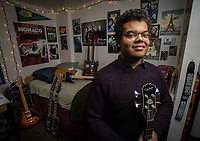 UAA Business Management Major Clifford W. Irwin Jr. poses with his guitar and rock poster collection in his room at UAA's East Hall. Irwin was one of the winners of UAA Residence Life's Room of the Year Competition.