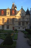 Paris Right Bank: The façade onto the garden of the Hotel de Sens in the Marais, in the late afternoon.  The building was the residence of the archbishops of Sens in the town from the end of the XIV century, and it has been entirely rearranged by one of them, Tristan de Salazar, at the end of the XV century. It has been restored at the beginning of 1900.<br /> <br /> You can download this file for (E&PU) only, but you can find in the collection the same one available instead for (Adv).