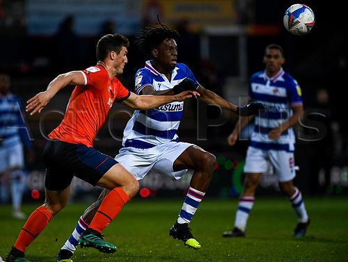 21st April 2021; Kenilworth Road, Luton, Bedfordshire, England; English Football League Championship Football, Luton Town versus Reading; Ovie Ejaria of Reading against Matty Pearson of Luton Town