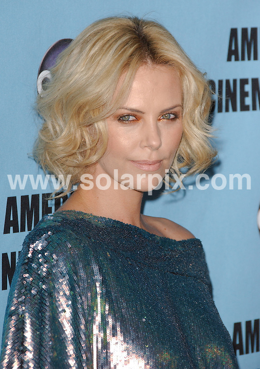 **ALL ROUND PICTURES FROM SOLARPIX.COM**.**SYNDICATION RIGHTS FOR UK, AUSTRALIA, DENMARK, PORTUGAL, S. AFRICA, SPAIN & DUBAI.The 24th Annual American Cinematheque Award Honoring Matt Damon - Arrivals, The Beverly Hilton Hotel / Beverly Hills, CA. USA, 28 March 2010.This pic: Charlize Theron.JOB REF: 10999  PHZ ortega DATE: 28_03_2010.**MUST CREDIT SOLARPIX.COM OR DOUBLE FEE WILL BE CHARGED**.**MUST NOTIFY SOLARPIX OF ONLINE USAGE**.**CALL US ON: +34 952 811 768 or LOW RATE FROM UK 0844 617 7637**