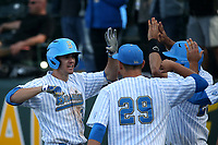 Ryan Kreidler (3) of the UCLA Bruins is greeted by Kyle Cuellar (29) and other teammates after hitting a home run against the Arizona Wildcats at Jackie Robinson Stadium on March 19, 2017 in Los Angeles, California. UCLA defeated Arizona, 8-7. (Larry Goren/Four Seam Images)
