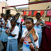 Young people play violins during a graduation ceremony at the Agostinho Neto University's (Universidade Agostinho Neto) law faculty.