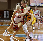 SIOUX FALLS, SD - MARCH 8: Hannah Sjerven #34 of the South Dakota Coyotes drives into Emily Dietz #34 of the North Dakota State Bison during the Summit League Basketball Tournament at the Sanford Pentagon in Sioux Falls, SD. (Photo by Richard Carlson/Inertia)
