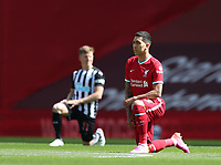 24th April 2021; Anfield, Liverpool, Merseyside, England; English Premier League Football, Liverpool versus Newcastle United; Roberto Firmino of Liverpool takes a knee to show support for the movement towards racial equality