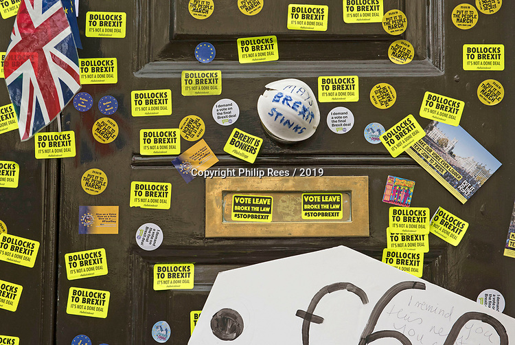 """Bollocks to Brexit stickers on the front doors of the Cabinet Office in Westminster during the """"Put it to the People"""" rally which made it's way through central London today. Demonstrators from across the country gathered to call for a second referendum on Brexit and to march through the UK capital finishing with speeches in Parliament Square opposite the Houses of Parliament in Westminster."""