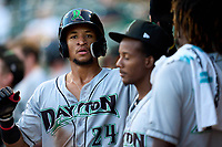 Dayton Dragons Allan Cerda (24) high fives teammates after scoring a run during a game against the Fort Wayne TinCaps on August 25, 2021 at Parkview Field in Fort Wayne, Indiana.  (Mike Janes/Four Seam Images)