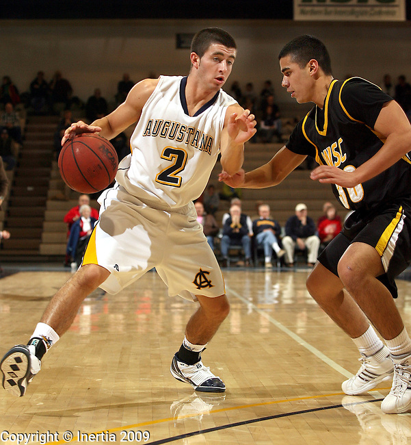 SIOUX FALLS, SD - DECEMBER 12: Cameron McCaffrey #2 of Augustana looks to make a move against Michael DiGregorio #30 from Wayne State in the first half of their game Saturday night at the Elmen Center in Sioux Falls. (Photo by Dave Eggen/Inertia)