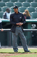 Home plate umpire Harley Acosta between innings of the South Atlantic League game between the Lakewood BlueClaws and the Kannapolis Intimidators at Kannapolis Intimidators Stadium on April 8, 2018 in Kannapolis, North Carolina.  The Intimidators defeated the BlueClaws 4-3 in game two of a double-header.  (Brian Westerholt/Four Seam Images)