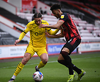 13th March 2021; Vitality Stadium, Bournemouth, Dorset, England; English Football League Championship Football, Bournemouth Athletic versus Barnsley; Callum Brittain of Barnsley competes for the ball with Lloyd Kelly of Bournemouth