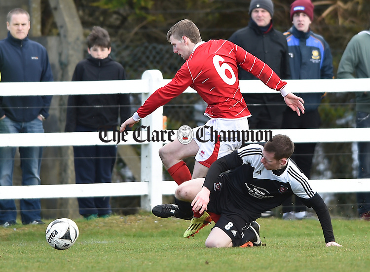Colin Smyth of Newmarket Celtic in action against Stephen Bradley of Janesboro during their Munster League Champions Trophy final at The County Grounds, Doora. Photograph by John Kelly.