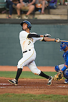 Trae Arbet (7) of the Bristol Pirates follows through on his swing against the Burlington Royals at Boyce Cox Field on July 10, 2015 in Bristol, Virginia.  The Pirates defeated the Royals 9-4. (Brian Westerholt/Four Seam Images)