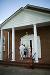 May 6, 2008. Apex, NC.. With the close North Carolina primary battle between Senators Hillary Clinton and Barack Obama, voters hit the polls to try and bring closure to this highly contested state and divide the delegates between the 2 candidates.. A sign directs voters to a church polling station.