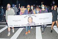 """A group of at least 1000 people marched in Boston, Massachusetts, on Fri., Sept. 25, 2020, to demand justice for the police killing of Breonna Taylor after this week's announcement that the Louisville, Kentucky, police officers would not be charged. The group marched from Nubian Square in Roxbury to the Boston Police Department Headquarters and then to downtown Boston. The killing of Breonna Taylor, along with the killing of other people of color by police in 2020 and previously, has led to widespread protest and demonstration throughout the country. This week's decision not to charge the officers in her killing has led to a recharged protest movement in Boston and elsewhere. <br /> The sign here reads """"Black Women Matter"""" and features a photo of Breonna Taylor."""