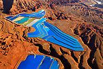 Pictured:  The electric blue 'pools' of potash near Moab, Utah, USA. <br /> <br /> Amazing aerial photos show off the majesty of America's landscape, its architecture, its industry and its wildlife.   From the startling blue potash pools of Utah to hundreds of aircraft sitting unused due to the pandemic, the images display a little seen side of the USA.<br /> <br /> Other images include a passenger plane plane as it touches down in California taken 4,500ft above it, fog over the Golden Gate Bridge and a solar farm in Nevada.   Professor of Music Jassen Todorov, from San Francisco, captured the striking pictures of the American West while flying in a light aircraft.   SEE OUR COPY FOR DETAILS<br /> <br /> Please byline: Jassen Todorov/Solent News<br /> <br /> © Jassen Todorov/Solent News & Photo Agency<br /> UK +44 (0) 2380 458800