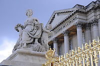 Versailles palace and statue on the gates, Paris