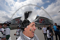 FAO: SPORTS PICTURE DESK-NO BYLINE PLEASE<br /> Pictured: Swansea City FC supporter Richard Clark with a mohican wig in his team's colours arriving to Wembley. Monday 30 May 2011<br /> Re: Reading v Swansea City Football Club npower Championship play-offs final at the Wembley Stadium, London.