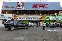 Yogyakarta, Java, Indonesia.  Computer Store, Kentucky Fried Chicken, Jl. Laksda Adisucipto Street.