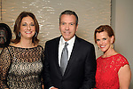 From left: Liz Zaruba, Bob Devlin and Jill Devlin at a dinner party honoring Best Dressed Hall of Fame honorees Lucinda Loya and Sue Smith at the Loya's residence Wednesday March 28,2012. (Dave Rossman/ For the Chronicle)