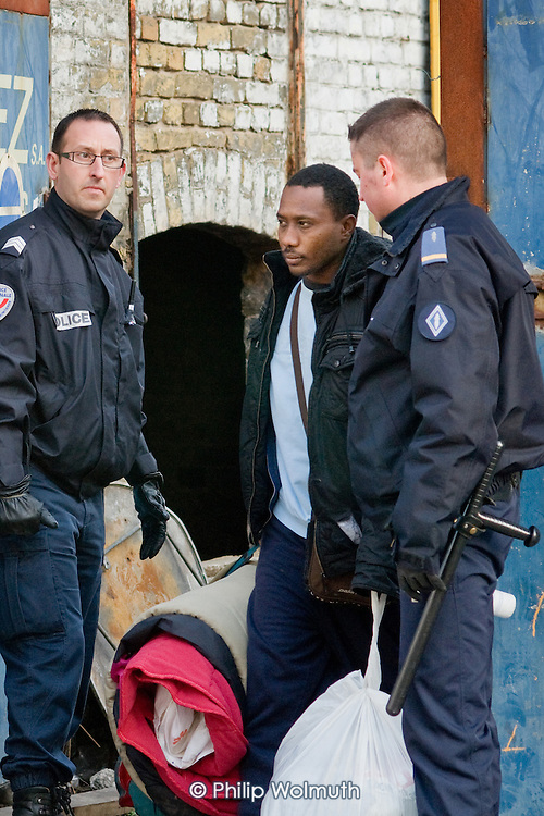 Following an early morning police raid, migrants are evicted from a squat in a disused warehouse in Calais known as the Africa House, used as a shelter by up to 100 people seeking to cross the Channel to the UK.