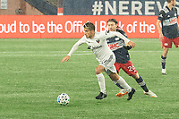 FOXBOROUGH, MA - NOVEMBER 1: Yamil Asad #11 of DC United as Thomas McNamara #26 of New England Revolution comes in to tackle during a game between D.C. United and New England Revolution at Gillette Stadium on November 1, 2020 in Foxborough, Massachusetts.
