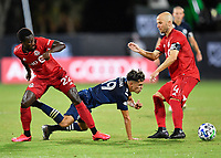 LAKE BUENA VISTA, FL - JULY 26: Jesús Medina of New York City FC is fouled by Richie Laryea of Toronto FC as Michael Bradley of Toronto FC looks on during a game between New York City FC and Toronto FC at ESPN Wide World of Sports on July 26, 2020 in Lake Buena Vista, Florida.