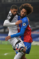 Ruben Loftus-Cheek of Fulham and Jaïro Riedewald of Crystal Palace battle for the ball during the Premier League behind closed doors match between Crystal Palace and Fulham at Selhurst Park, London, England on 28 February 2021. Photo by Vince Mignott / PRiME Media Images.