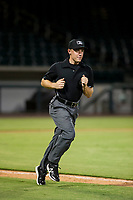 Minor league baseball umpire Bobby Tassone jogs towards the outfield during a game between the AZL Padres 2 and the AZL Cubs on August 28, 2017 at Sloan Park in Mesa, Arizona. AZL Cubs defeated the AZL Padres 2 9-4. (Zachary Lucy/Four Seam Images)