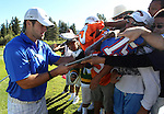 Denver Broncos quarterback Tim Tebow signs autographs during a practice round at the 22nd American Century Celebrity Golf Championship at Edgewood Tahoe Golf Course in Stateline, Nev., on Thursday, July 14, 2011. Tebow's brother Robby is at right. .Photo by Cathleen Allison