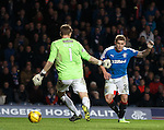 Martyn Waghorn scores the killer fourth goal for Rangers past Hibs keeper Mark Oxley