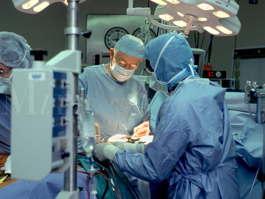 Doctors and medical professionals during heart surgery.