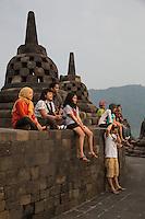 Borobudur, Java, Indonesia.  Early-morning Visitors to the Temple, awaiting Sunrise.