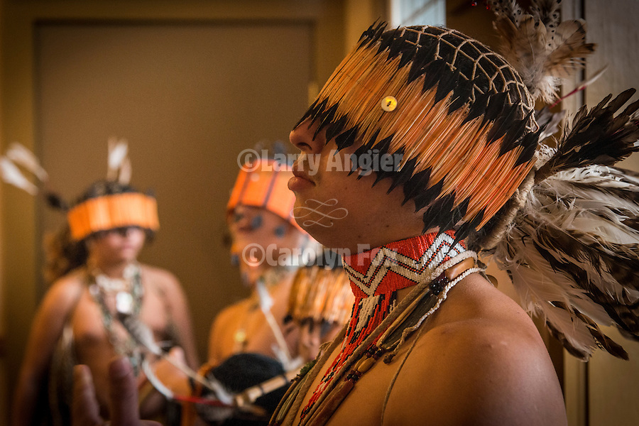 Amah Mutsun Tribal Band of Costonoan/Ohlone Indians dance with traditional dance at the community center in  San Juan Bautista, California...The dancing began the ceremonies during the solstice that  included the Mass of Reconciliation by the Monterey Diocese of the Catholic Church.