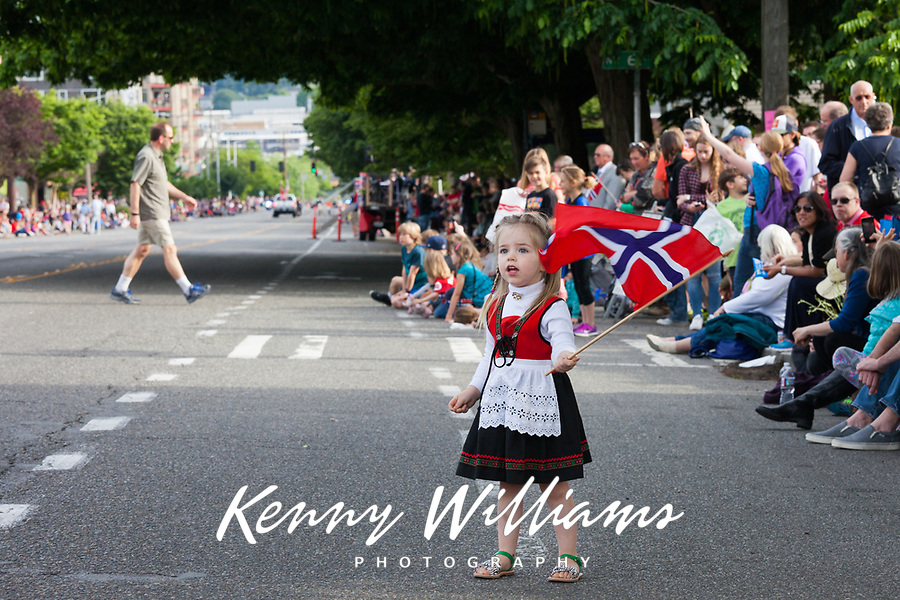 Little girl waving Norwegian Flag, 17th of May Parade 2016, Ballard, Seattle, WA, USA.
