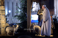 Pope Francis prays in front of a Nativity.In the year of the Jubilee of Mercy, also the Nativity of St. Peter's Square he is dedicated to Mercy. In the first scene, in fact, there is a man from comfort to a traveler. the Vatican on December 31, 2015
