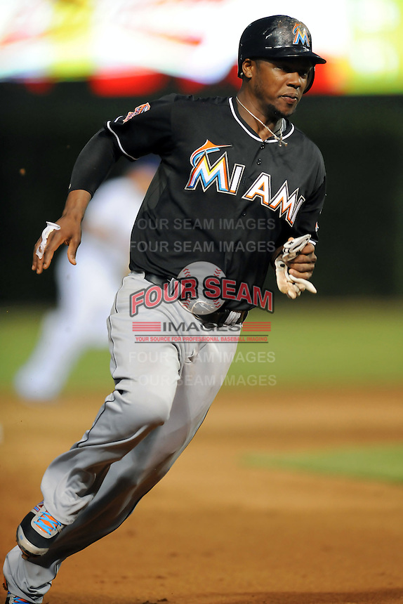 Miami Marlins third baseman Hanley Ramirez #2 rounds third during a game against the Chicago Cubs at Wrigley Field on July 17, 2012 in Chicago, Illinois. The Marlins defeated the Cubs 9-5. (Tony Farlow/Four Seam Images).