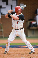 Greg Hopkins #11 of the St. John's Red Storm at bat against the Ole Miss Rebels at the Charlottesville Regional of the 2010 College World Series at Davenport Field on June 6, 2010, in Charlottesville, Virginia.  The Red Storm defeated the Rebels 20-16.  Photo by Brian Westerholt / Four Seam Images