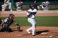 Alexander Ovalles (26) of the Charleston RiverDogs follows through on his swing against the Augusta GreenJackets at Joseph P. Riley, Jr. Park on June 27, 2021 in Charleston, South Carolina. (Brian Westerholt/Four Seam Images)