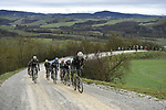 The peleton hit the white dirt roads of Monte Santa Maria during the 2018 Strade Bianche Men Elite NamedSport race running 184km from Siena to Siena, Tuscany, Italy. 3rd March 2018.<br /> Picture: LaPresse/Fabio Ferrari | Cyclefile<br /> <br /> <br /> All photos usage must carry mandatory copyright credit (© Cyclefile | LaPresse/Fabio Ferrari)