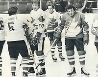 1976 FILE PHOTO - ARCHIVES -<br /> <br /> Phil Esposito (right) is growling even at first workout of team canada. New York superstar with Pete Mahovlich and Steve Shutt in practice at Montreal Forum<br /> <br /> Bezant, Graham<br /> Picture, 1976,<br /> <br /> 1976<br /> <br /> PHOTO : Graham Bezant - Toronto Star Archives - AQP