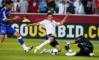 Benny Feilhaber of the USA shoots in front of a sliding Miguel Montes of El Salvador during a World Cup Qualifying match at Rio Tinto Stadium, in Sandy, Utah, Friday, September 5, 2009.  The USA won 2-1..
