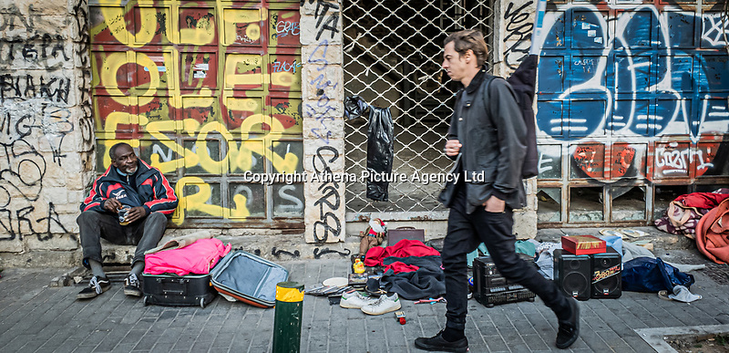 Pictured: A homeless man with his belongings.<br /> Re: Street photography, Athens, Greece. Thursday 27 February 2020